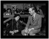 Fred Astaire Seated in Suit with Girl High Quality Photo