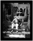 Fred Astaire Seated on Stairs in Black and White High Quality Photo