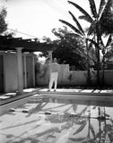 Fred Astaire standing by the Poolside in Black and White Premium Art Print