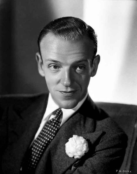 Fred Astaire Posed in Black Suit, Seated on Couch Premium Art Print