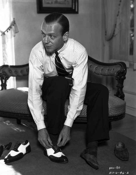 Fred Astaire Seated on Couch while wearing Shoe Premium Art Print