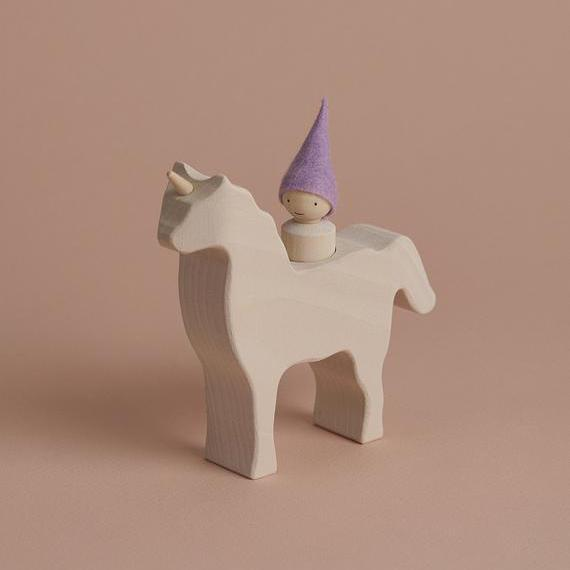 Wooden Unicorn and Little Gnome