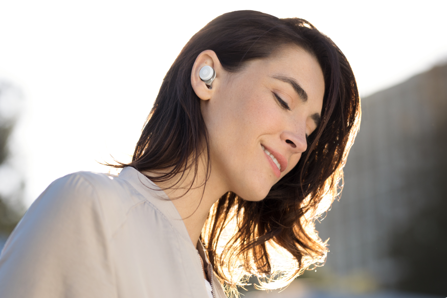 Woman listening with earbuds