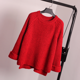 Loose long sleeved knitted sweater