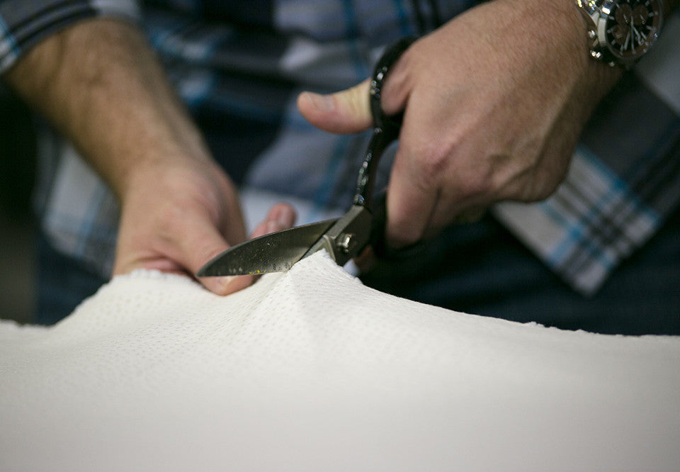 craftsmen handcrafting a mattress