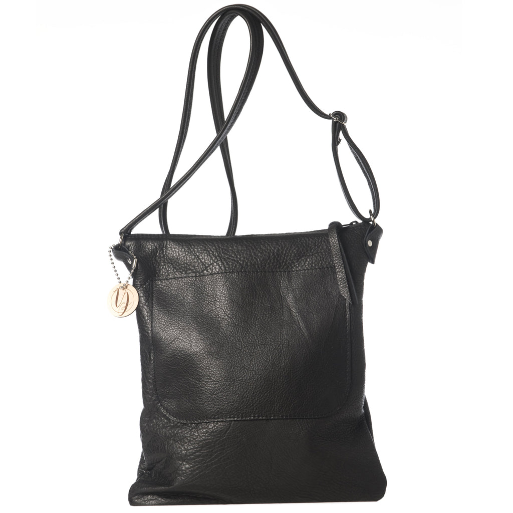 Black leather cross-body bag handmade in the USA by Vicki Jean.