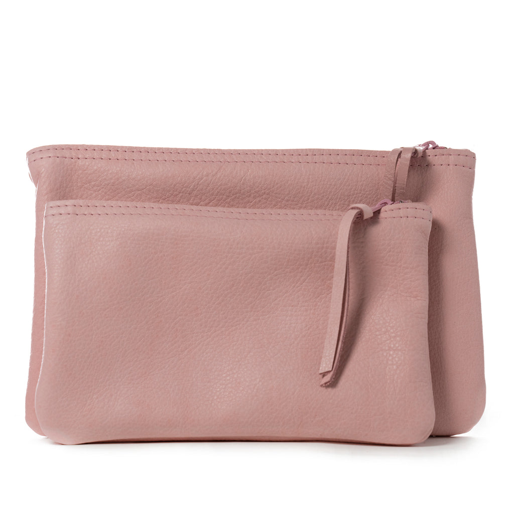 Pink leather zippered clutch handmade in the USA by Vicki Jean.