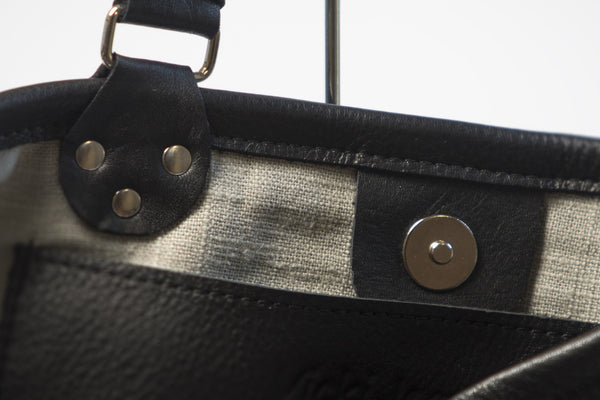 Black leather with grey lining by Vicki Jealn