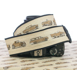 camera strap antique car