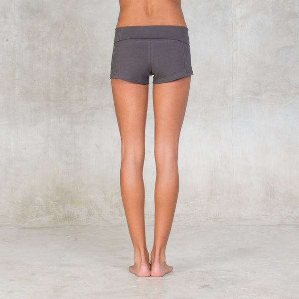 Fold-over waistband yoga shorts. Made of certified organic cotton, breathable, perfect for yoga practice, wear them high waisted or low waist. Sustainable, eco-friendly & slow fashion.