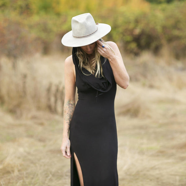 Long maxi dress made of very soft natural, breathable fiber. With a cowl neck piece that converts into a hood or a shawl. A wardrobe staple. Slow and sustainable fashion.