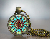 Hand crafted Round Glass Pendant set in Brass - Turquoise/Brown Mandala
