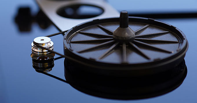Belt drive turntable pulleys and sub-platter