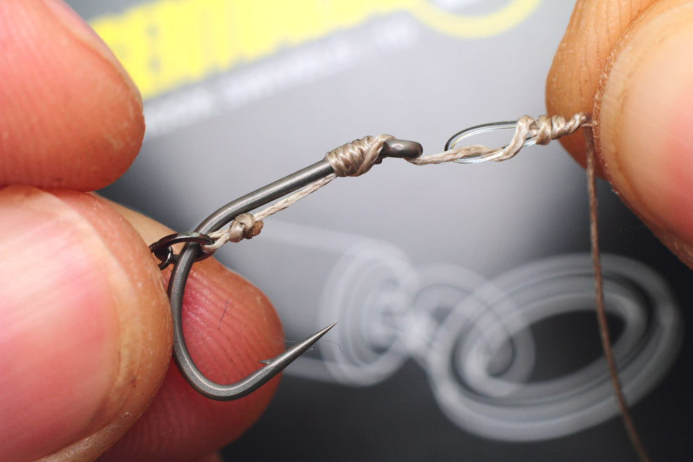 How to tie a Combi rig: Now whip the braid around the doubled over section of fluorocarbon, 5-7 turns will be fine