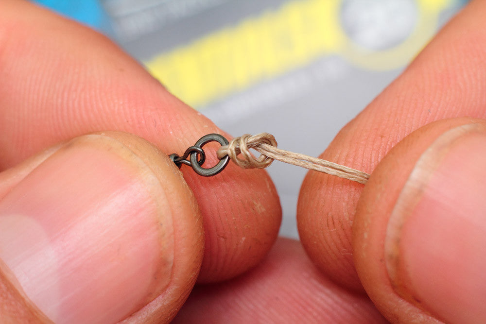 Now tie an overhand loop to contain the micro hook ring swivel