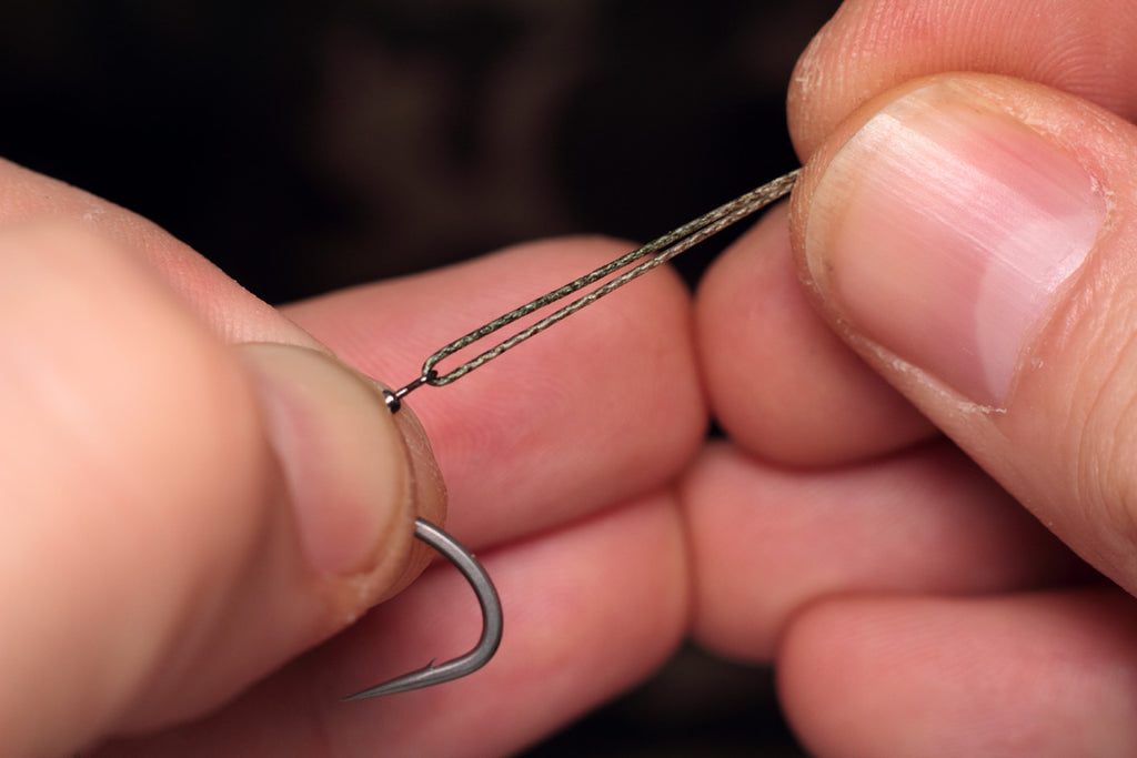double over a short length of coated braid or nylon in the micro hook ring swivel
