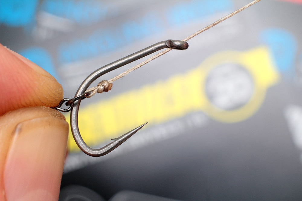 Move the micro hook ring swivel round to the bend of the hook