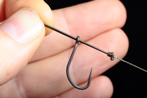 Holding the Chod hook secureley Push the loop through the eye from front to back