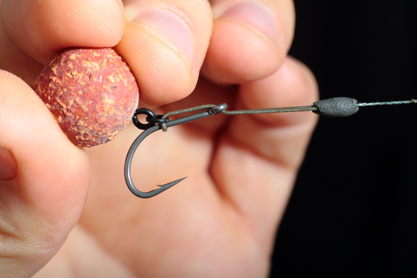 Pull the loop back through the eye of the Chod hook until it's around halfway down the shank