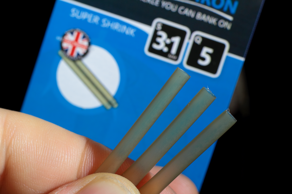 Use a little bit of our trans Khaki shrink tubing to trap the loop of the Multi rig and prevent it from slipping