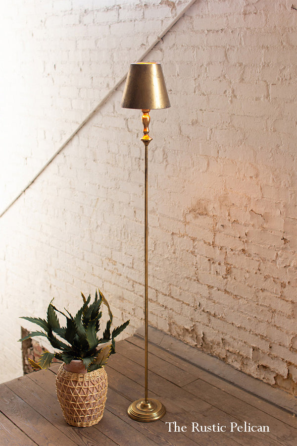 tall modern stylish gold lamp with a beautiful gold shade