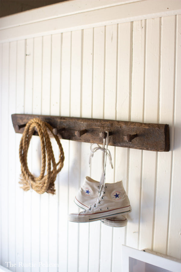 Reclaimed wood coat rack with antique nails and boltz