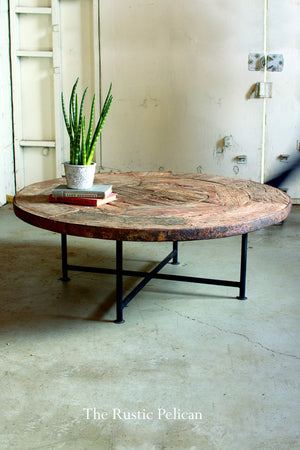 Rustic coffee table made of a reclaimed wood wagon wheel