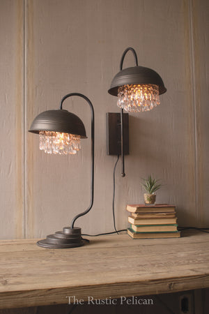 Rustic raw metal table lamp adorned with crystals