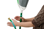Person with stroke holds her own broom and hose with the help of an eazyhold aqua grip aid.