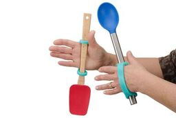 Hands of a person with poor grip strength hold kitchen implements with the eazyhold aqua silicon universal cuffs.