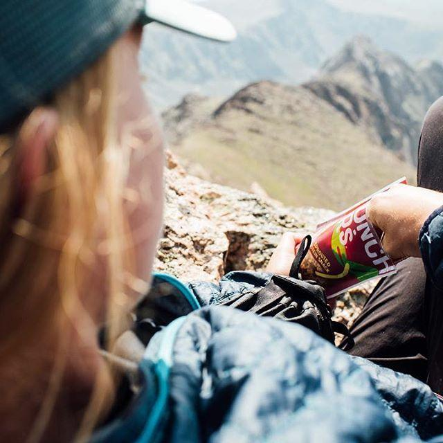 Hiker relaxing while eating Crunchsters