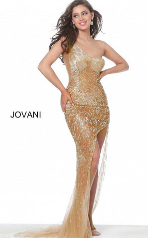 Jovani 02494 One shoulder beaded nude gold evening gown prom dress. Gold prom dress with sheer illusion bead embellishments, asymmetrical neckline, and a one-shoulder bodice, low open back with criss-cross strap and floor-length fitted skirt with side high-low slit. Available colors:  Nude Gold