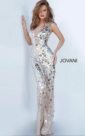 Jovani 02507 is a 2021 Prom, Pageant & Formal Wear Jumpsuit! Featuring a Plunging V Neck and open back. Embellishments cluster along the bodice of this pant suit and cascade  down into the slightly flared hem of this prom jumpsuit. This Jovani 02507 nude sleeveless jumpsuit is fashioned in glass beaded mesh over a solid lining, with plunging V-neckline, sheer side insets, and open V-back. The fitted pants finish in a slightly flared hem. Glass Slipper Formals