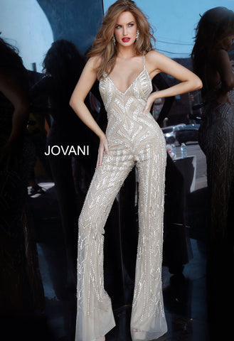 Jovani 02562 is a 2020 Prom, Pageant & Formal Evening Wear Jumpsuit. Featuring a Nude base with Geometric Silver Embellishments. Crystal accented spaghetti straps with an embellished bodice v neckline. Long Straight leg with flared hem.   Available Sizes: 00,0,2,4,6,8,10,12,14,16,18,20,22,24  Available Colors: Nude/Silver