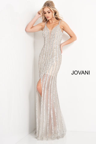 Jovani 03185 is a long Fully Embellished formal evening gown. Featuring a Plunging V Neckline and open V Back. Rows of Crystal Rhinestones, Sequins & Beading Embellish this prom Dress leading into a sheer skirt with a slit. Embellished spaghetti straps. Available Sizes: 00,0,2,4,6,8,10,12,14,16,18,20,22,24  Available Colors: Black, Silver