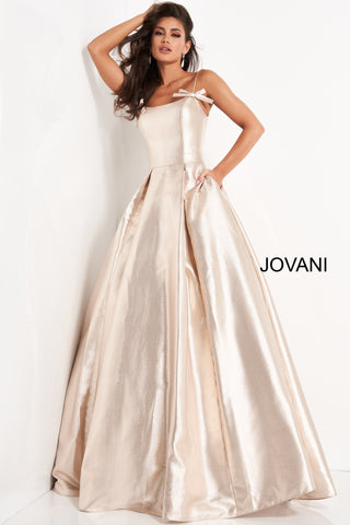 Jovani 03479 is a Long metallic shimmer A Line Ball Gown Prom Dress. Scoop neckline with spaghetti straps and accent bows. Pleated ballgown skirt with pockets! Great Pageant & Prom Dress! Available Sizes: 00,0,2,4,6,8,10,12,14,16,18,20,22,24  Available Colors: Champagne, Blue