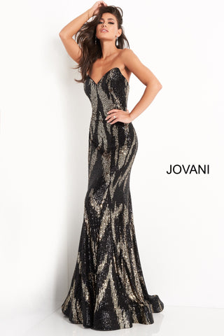 Jovani 04155 This is a long sequin embellished prom dress with a two tone sequin design.  This evening pageant gown has a flared skirt and sweeping train.  Colors  Gold/Black, Purple/Red, Silver/Red, Yellow/Silver  Sizes  00, 0, 2, 4, 6, 8, 10, 12, 14, 16, 18, 20, 22, 24