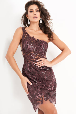 Jovani 04190 is a short fitted formal cocktail dress. This one shoulder gown features a sheer Bodice with sequin accented floral lace patterns. This gown is Great for so many events! Sheer & Sexy this gown will steal the show at any formal event! Available Sizes: 00,0,2,4,6,8,10,12,14,16,18,20,22,24  Available Colors: dark plum, red, white