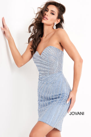Jovani 04577 is a short fitted formal cocktail Dress. This Homecoming Gown Features a sheer corset style fitted bodice with boning and a strapless sweetheart neckline. This Evening gown is fully Embellished & Beaded in a starburst pattern from the side. Stunning short dress for almost any formal Event!  Available Sizes: 00,0,2,4,6,8,10,12,14,16,18,20,22,24  Available Colors: Blue, Pink