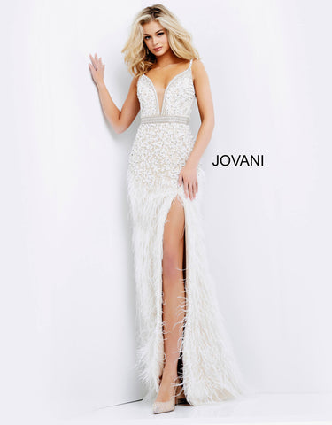 Jovani 04626 This is a fully embellished long prom, pageant and evening gown with a plunging v neckline with illusion panel and embellished belt.  The long skirt on this prom dress has feather details from the side slit to the floor creating a modified fit and flare design. Colors  Black/Nude, Ivory/Nude  Sizes:  00, 0, 2, 4, 6, 8, 10, 12, 14, 16, 18, 20, 22, 24