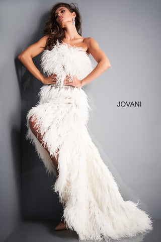Jovani 04936 off white formal gown features an A-line silhouette with ostrich feathers on the strapless straight neckline and all over the skirt. Crystal beads add glitz to this high-low prom dress, finished with a semi-open back and a sweep train. This Lush style oozes Couture Glam! Great formal Evening gown, Wedding reception dress & More! Available Sizes: 00,0,2,4,6,8,10,12,14  Available Colors: Off White