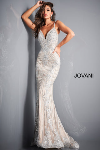 Jovani 05752 This is a silver and nude long mermaid prom dress with embellished lace throughout the evening gown.  It has a v neckline and spaghetti straps. Colors: Silver Nude  Sizes  00-24