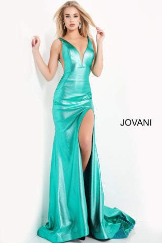 Jovani 06125 is a gorgeous Long Fitted metallic shimmer Formal Evening Gown. Plunging Deep V Neckline with an open V Back. Fit & Flare silhouette with s slit in the thigh and a lush trumpet skirt with Gorgeous sweeping train. Sheer side panels with mesh insert.