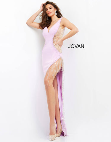 Jovani 06245 This is a long sexy prom, pageant and formal evening dress with a plunging v neckline and a V back.  This evening gown features a hip high side slit that is trimmed in fringe and embellished sheer sides.  This high low dress has a small sweeping train. Colors  Black, Purple, White  Sizes  00-24