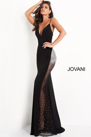 Jovani 06566 is a long fitted formal evening gown. Featuring a deep V Neckline with spaghetti straps and an open back. Sheer side panel on skirt has crystal rhinestones along the hip area dispersing as it flows down the skirt. Great Red Carpet Sexy Black Dress. Available Sizes: 00,0,2,4,6,8,10,12,14,16,18,20,22,24  Available Colors: Black, Light Blue, Red