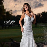 Adagio Bridal W9373 plunging v neckline sequin applique lace fit and flare mermaid wedding dress bridal gown with sheer lace sides and back and bridal buttons down the back. Color Ivory  Sizes 00, 0, 2, 4, 6, 8, 10, 12, 14, 16, 18, 20, 22, 24, 26, 28, 30