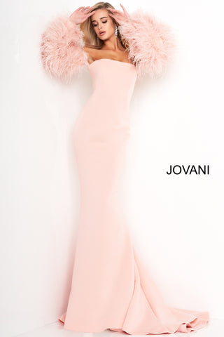 Jovani 1226 is a Long Fitted Mermaid Scuba Formal Evening Gown. This Straight neckline with Long Off the Shoulder Feather Sleeves. This Fit & Flare Wedding Dress Features a Lush Sweeping train. Great Red Carpet or formal event gown. Great for a wedding guest dress or mother of the bride gown. Stretch scuba fabric, form fitting silhouette, floor length with train, strapless bodice, straight neckline, ostrich feather sleeves. Available Sizes: 00-24  Available Colors: black, blush, white, white/black