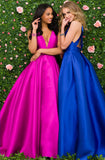 JVN47530 This gorgeous prom dress has a deep V plunging neckline and features straps on an open back with a neat bow tie and a full pleated ballgown skirt. Pockets