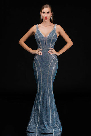Nina Canacci 1471 is a long Iridescent Shimmer form fitted Prom & Pageant Dress. Plunging Neckline with a mesh insert an open v back. Rhinestone rows embellish the bodice and cascade down into the flared skirt.   Available Sizes: 0-14  Available Colors: Blue, Gold
