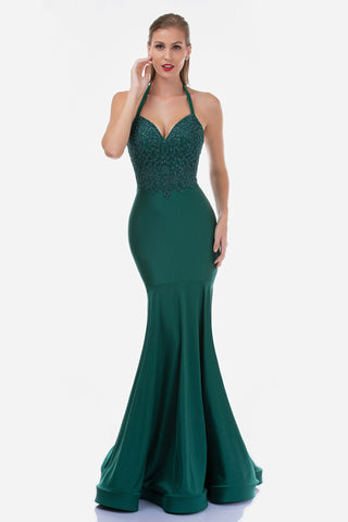 Nina Canacci 1474 is a Long Fit & Flare Prom Dress & Pageant Gown. This formal gown features an Embellished Lace V Neckline Bodice with a Halter top. Fit & Flare Mermaid Silhouette with a sweeping train. Great wedding guest dress & Bridesmaid Gown. Simple Wedding Destination dress.  Available Sizes: 0-12  Available Colors: Ivory, Green